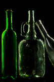 Glass bottle, empty, original, on black background Royalty Free Stock Photography