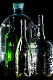 Glass bottle, empty, original, on black background Royalty Free Stock Image