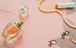 Glass bottle of female perfume on a pink background Stock Photo