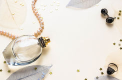 Glass bottle of female perfume on a white background Stock Photos