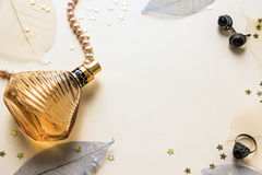 Glass bottle of female perfume on a white background Royalty Free Stock Photos