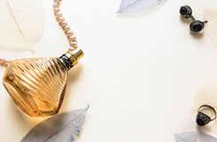 Glass bottle of female perfume on a white background Stock Image