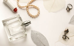 Glass bottle of female perfume on a white background Stock Images