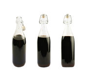 Glass bottle filled with liquor Stock Images