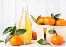 Glass bottle of fresh mandarin tangerine juice stock image
