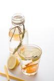 Glass and bottle of frozen homemade lemonade Stock Photos