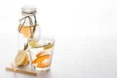 Glass and bottle of frozen homemade lemonade Royalty Free Stock Image