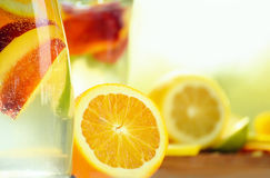 Glass bottle with a fruit drink Royalty Free Stock Photos