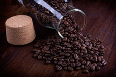 Glass bottle full of coffee beans Royalty Free Stock Photos