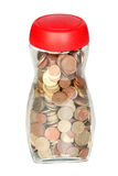 Glass bottle full of coins Royalty Free Stock Image