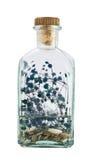 Glass bottle full of herbs Stock Images