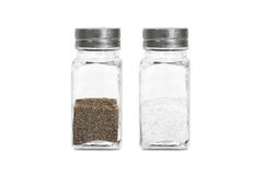 A glass bottle with ground pepper and salt. Isolated on white background royalty free stock photography