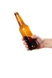 Glass bottle in hand Stock Photos