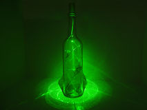 Glass bottle in laser abstraction Stock Photo