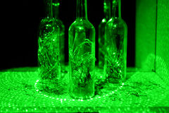 Glass bottle in laser lights. Stock Images