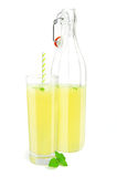 Glass and bottle of lemonade. Glass of lemonade with straw and bottle Stock Photo