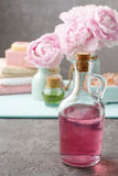 Glass bottle of liquid soap and peonies Stock Images