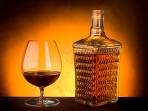 Glass and bottle of liquor royalty free stock photography
