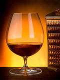 Glass and  bottle of liquor. Glass and luxury bottle of liquor Stock Photography