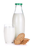 Glass, bottle of milk and cookies Stock Photo