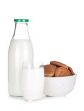 Glass, bottle of milk and cookies bowl Stock Photography