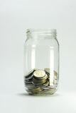 Glass bottle with money coins Royalty Free Stock Photography
