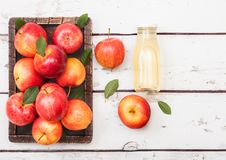 Free Glass Bottle Of Fresh Organic Apple Juice With Pink Lady Red Apples In Vintage Box On Wooden Background Royalty Free Stock Image - 127236656