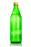 Glass Bottle Of Iced Mineral Water Royalty Free Stock Photos