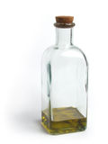 Glass Bottle with Olive Oil. Square glass bottle with cork, filled with olive oil stock photography