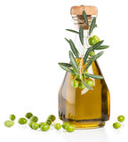 Glass bottle of olive oil with branch of olives Stock Photo