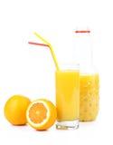 Glass and a bottle of orange juice. Orange juice and two oranges isolated on white stock photo