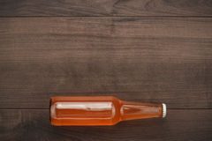 Glass bottle of orange sweet drink Royalty Free Stock Photos