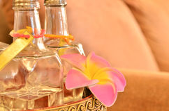 Glass bottle with pink flower - spa Royalty Free Stock Photography