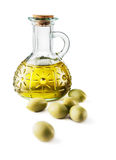Glass bottle of premium virgin olive oil and some. Olives on white background -Clipping Path royalty free stock photos