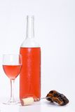 Glass and bottle of red or rose wine Royalty Free Stock Photos