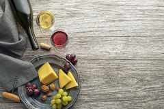 Wine bootle and glass with food on wooden table stock photo