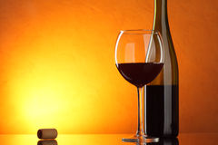 Glass and bottle of red wine Stock Photography