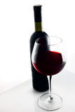 Glass and Bottle of red wine. Royalty Free Stock Photos