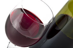 Glass and bottle of red wine. On white background Stock Photography