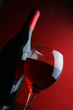 Glass and bottle of red wine Stock Image