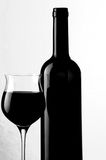 Glass and bottle of red wine Royalty Free Stock Images