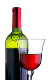 Glass and bottle of red wine Stock Photos
