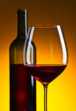 Glass and bottle with red  wine Stock Images
