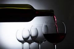 Glass and bottle of red wine. Stock Photography