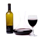 Glass and bottle of red wine decanter Royalty Free Stock Images