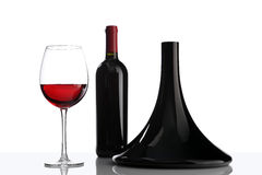 Glass and bottle of red wine decanter on white Royalty Free Stock Images