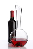 Glass and bottle of red wine decanter on white Stock Image