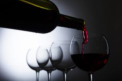 Glass and bottle of red wine. Stock Images