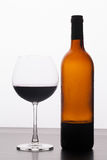 Glass and a bottle of red wine Stock Images