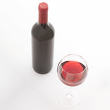 Glass and bottle of red wine. Top view unusually Stock Photography
